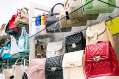 Elegant, modern, new, colorful bags in an accessories store Stock Photos