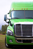 Elegant modern semi truck in green on green parcking lot Royalty Free Stock Photo