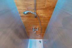 Elegant Modern Shower Cabin. Elegant and Modern Bathroom Shower Cabin. Wide Angle Photo. Wood Imitation Bathroom Tiles royalty free stock photos