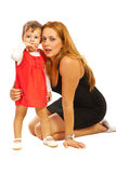Elegant mother and girl Stock Images