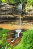 Elegant Munising Falls, Michigan. Green leaves surround the beautiful Munising Falls, Michigan royalty free stock image