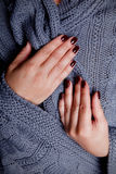 Elegant nails for autumn and winter. Elegant burgundy nails made by gel polish Stock Photography