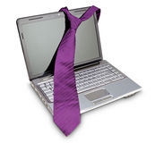 Elegant necktie on a laptop computer as a symbol of fashion. Stock Images
