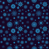 Elegant neon blue snowflakes of various styles isolated on dark background Royalty Free Stock Photography