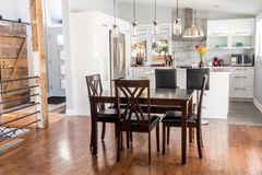 Elegant new modern home dining room. And kitchen stock image
