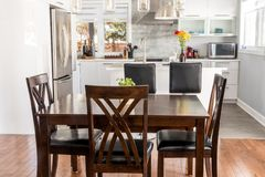 Elegant new modern home dining room. And kitchen royalty free stock image