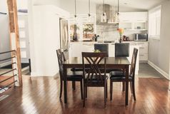 Elegant new modern home dining room. And kitchen royalty free stock photography