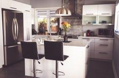 New modern home kitchen with island. Elegant new modern home kitchen with island royalty free stock photo