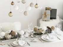 Table served for New Year dinner in living room. Elegant New Years Party Decoration For Dining Room Stock Image