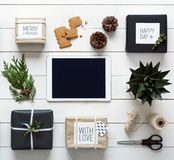 Elegant nordic christmas background, desk view from above, online shopping concept Stock Photography