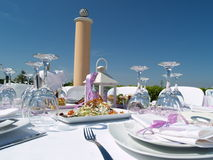 Elegant outdoor table setting. A closeup view of an elegant outdoor table setting at a wedding reception stock photo