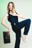 Elegant outfit. Stylish woman with black handbag Royalty Free Stock Images