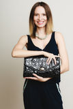 Elegant outfit. Stylish woman with black handbag Royalty Free Stock Images