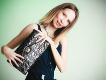 Elegant outfit. Stylish woman with black handbag Stock Image