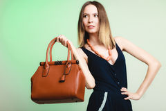 Elegant outfit. Stylish woman with brown bag Royalty Free Stock Photography