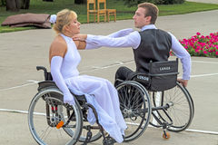 Elegant pair wheelchair dancing Stock Image