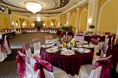 Elegant party hall. With table and chair covers stock photography