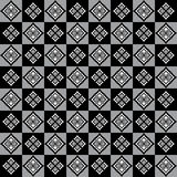 Elegant pattern with rhomboid decorations on alternate grey and black squares Royalty Free Stock Photo