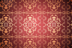 Elegant patterned wallpaper in red and gold Royalty Free Stock Image
