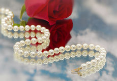 Elegant pearls over glass with cloudsllow dept Royalty Free Stock Images