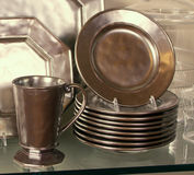 Elegant Pewter Dinner Plates And Mug. Metallic pewter plates with serving tray and mugs Royalty Free Stock Image