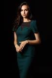 Elegant photo of beautiful woman in green dress Stock Photo