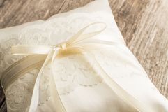 Elegant pillow or cushion for rings. Wedding ceremony.  Stock Photos