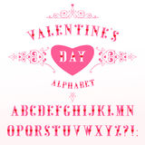 Elegant pink alphabet with red hearts in retro style. Decorative alphabet with red hearts on a white background. Luxury Elegant Happy Valentine Day festive Stock Photos