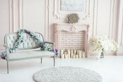 Free Elegant Pink Pastel Fireplace Decorated With Spring Flowers, Candles Royalty Free Stock Photography - 163578077