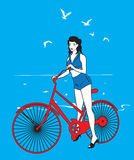 Elegant pinup girl on a bicycle Royalty Free Stock Image