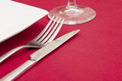 Elegant place setting on red Royalty Free Stock Photography