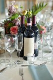 Elegant place setting with wine bottles Royalty Free Stock Photos