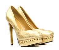 Elegant platform high heels shoes in gold. And with rhinestone decoration royalty free stock photo