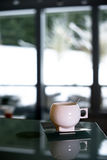 Elegant porcelain cup with stainless steel spoon and saucer Stock Images