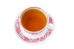 Elegant porcelain cup of tea. Isolated over white Royalty Free Stock Images