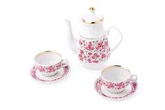 Elegant porcelain tea set. Isolated over white Royalty Free Stock Image