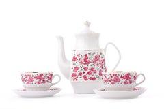 Elegant porcelain tea set. Isolated over white royalty free stock photography