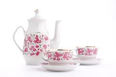 Elegant porcelain tea set. Isolated over white royalty free stock images