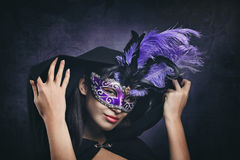 Elegant portrait of a masked woman stock images
