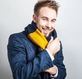 Elegant & Positive young handsome man in colorful scarf. Studio fashion portrait. Stock Photo