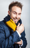 Elegant & Positive young handsome man in colorful scarf. Studio fashion portrait. Stock Images