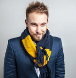 Elegant & Positive young handsome man in colorful scarf. Studio fashion portrait. Royalty Free Stock Images
