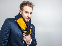 Elegant & Positive young handsome man in colorful scarf. Studio fashion portrait. Stock Image