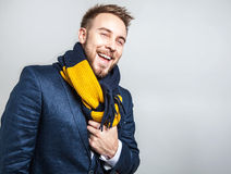 Elegant & Positive young handsome man in colorful scarf. Studio fashion portrait. Stock Photography