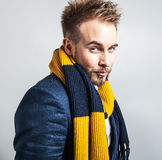 Elegant & Positive young handsome man in colorful scarf. Studio fashion portrait. Royalty Free Stock Photos
