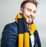 Elegant & Positive young handsome man in scarf. Studio fashion portrait. Stock Images