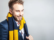 Elegant & Positive young handsome man in scarf. Studio fashion portrait. Royalty Free Stock Images