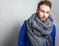 Elegant & Positive young handsome man in scarf. Studio fashion portrait. Stock Image