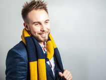 Elegant & Positive young handsome man in scarf. Studio fashion portrait. Stock Photos