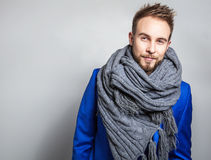 Elegant & Positive young handsome man in scarf. Studio fashion portrait. Stock Photo
